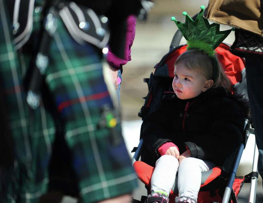 Three-year-old Rylan Mastroni, of Seymour, watches the marchers during the annual St. Patrick's Day Parade in downtown Milford, Conn. Saturday, Mar. 9, 2013. Photo: Autumn Driscoll / Connecticut Post
