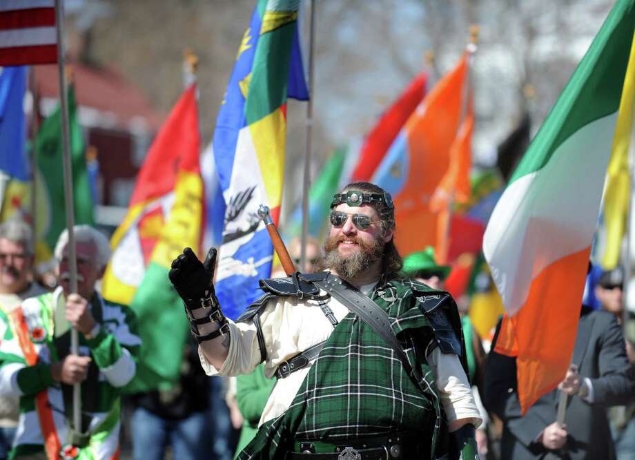 Dave Conroy marches with the Irish Heritage Society of Milford during the annual St. Patrick's Day Parade in downtown Milford, Conn. Saturday, Mar. 9, 2013. Photo: Autumn Driscoll / Connecticut Post