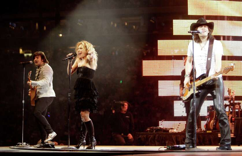 The Band Perry performs at RodeoHouston in Reliant Stadium Saturday, March 9, 2013, in Houston.
