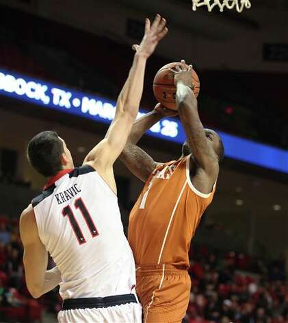 Texas' Sheldon McClellan shoots against Texas Tech's Dejan Kravic during am NCAA college basketball game in Lubbock, Texas, Saturday, March 9, 2013. (AP Photo/Lubbock Avalanche-Journal, Zach Long) Photo: Zach Long, Associated Press / Lubbock Avalanche-Journal