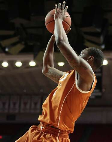 Texas' Sheldon McClellan shoots against Texas Tech during an NCAA college basketball game in Lubbock, Texas, Saturday, March 9, 2013. (AP Photo/Lubbock Avalanche-Journal, Zach Long) Photo: Zach Long, Associated Press / Lubbock Avalanche-Journal