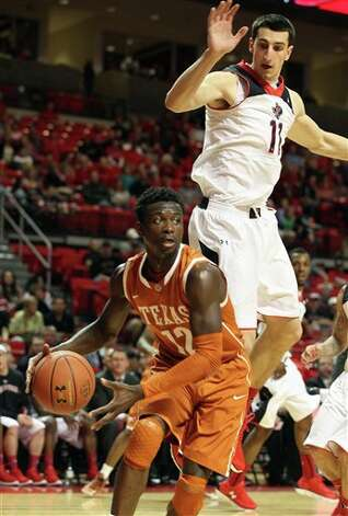 Texas' Myck Kabongo drives under pressure from Texas Tech's Dejan Kravic during an NCAA college basketball game in Lubbock, Texas, Saturday, March 9, 2013. (AP Photo/Lubbock Avalanche-Journal,Zach Long) Photo: Zach Long, Associated Press / Lubbock Avalanche-Journal