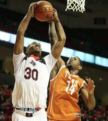 Texas Tech's Jaye Crockett shoots ahead of Texas' Julien Lewis during an NCAA college basketball game in Lubbock, Texas, Saturday, March 9, 2013. (AP Photo/Lubbock Avalanche-Journal,Zach Long) Photo: Zach Long, Associated Press / Lubbock Avalanche-Journal