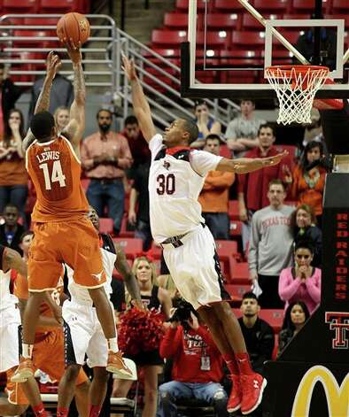 Texas' Julien Lewis (14) makes the game-winning basket over Texas Tech's Jaye Crockett (30) in an NCAA college basketball game in Lubbock, Texas, Saturday, March 9, 2013. (AP Photo/Lubbock Avalanche-Journal, Zach Long)  ALL LOCAL TV OUT Photo: Zach Long, Associated Press / Lubbock Avalanche-Journal