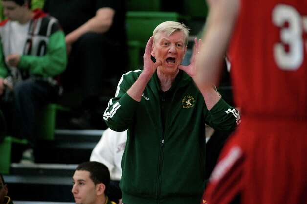 Trinity Catholic head coach Mike Walsh yells instructions to his team during playoff action in Stamford on Saturday against E O Smith.© J. Gregory Raymond Photo: J. Gregory Raymond / Stamford Advocate Freelance;  © J. Gregory Raymond