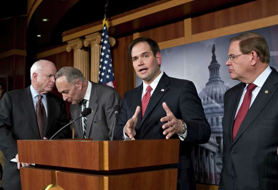 "John McCain (from left), Charles Schumer, Marco Rubio and Robert Menendez, along with Lindsey Graham, Dick Durbin, Jeff Flake and Michael Bennet, comprise the ""Gang of Eight."" Photo: J. Scott Applewhite / Associated Press"