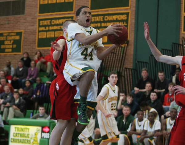 Trinty Catholic basketball player Wyatt Garyk drives hard to the basket during second half action at Trinity Catholic on Saturday. © J. Gregory Raymond for The Advocate Photo: J. Gregory Raymond / Stamford Advocate Freelance;  © J. Gregory Raymond