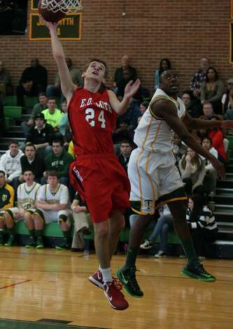 Mitch Foster of E O Smith goes up for two points during first half playoff action against Trinity. Trinity won the game going away, 75-55.© J. Gregory Raymond Photo: J. Gregory Raymond / Stamford Advocate Freelance;  © J. Gregory Raymond