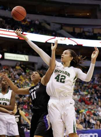 Baylor's Brittney Griner (42) and Kansas State's Chantay Caron (11) reach for a rebound during the second half of an NCAA college basketball game in the Big 12 Conference tournament Saturday March 9, 2013, in Dallas. Baylor won 80-47. (AP Photo/LM Otero) Photo: LM Otero, Associated Press / AP