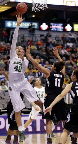 Baylor's Brittney Griner (42) shoots over Kansas State's Chantay Caron (11) during the second half of an NCAA college basketball game in the Big 12 Conference tournament Saturday March 9, 2013, in Dallas. Baylor won 80-47. (AP Photo/LM Otero) Photo: LM Otero, Associated Press / AP