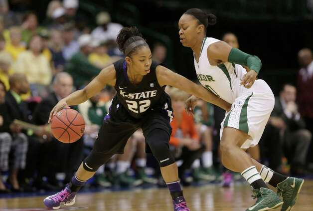 Kansas State's Mariah White (22) tries to keep the ball away from Baylor's Odyssey Sims during the first half of an NCAA college basketball game in the Big 12 Conference women's tournament Saturday, March 9, 2013, in Dallas. Baylor won 80-47. (AP Photo/LM Otero) Photo: LM Otero, Associated Press / AP