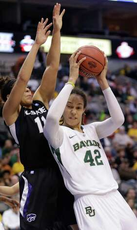 Baylor's Brittney Griner (42) is defended by Kansas State's Chantay Caron (11) during the second half of an NCAA college basketball game in the Big 12 Conference tournament on Saturday March 9, 2013, in Dallas. Baylor won 80-47. (AP Photo/LM Otero) Photo: LM Otero, Associated Press / AP