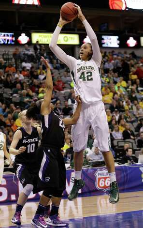 Baylor's Brittney Griner (42) shoots over Kansas State's Mariah White (22) during the second half of an NCAA college basketball game in the Big 12 Conference tournament Saturday March 9, 2013, in Dallas. Baylor won 80-47. (AP Photo/LM Otero) Photo: LM Otero, Associated Press / AP