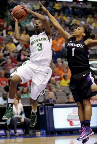 Baylor Jordan Madden (3) shoots against Kansas State guard Haley Texada (1) during the first half of an NCAA college basketball game in the Big 12 Conference tournament Saturday March 9, 2013, in Dallas. (AP Photo/LM Otero) Photo: LM Otero, Associated Press / AP