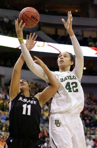 Baylor's Brittney Griner (42) and Kansas State's Chantay Caron (11) reach for the rebound during the second half of an NCAA college basketball game in the Big 12 Conference tournament on Saturday March 9, 2013, in Dallas. Baylor won 80-47. (AP Photo/LM Otero) Photo: LM Otero, Associated Press / AP