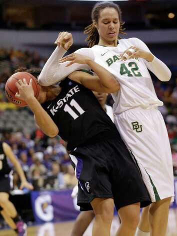 Baylor's Brittney Griner (42) is fouled by Kansas State's Chantay Caron (11) during the second half of an NCAA college basketball game in the Big 12 Conference tournament on Saturday March 9, 2013, in Dallas. Baylor won 80-47. (AP Photo/LM Otero) Photo: LM Otero, Associated Press / AP