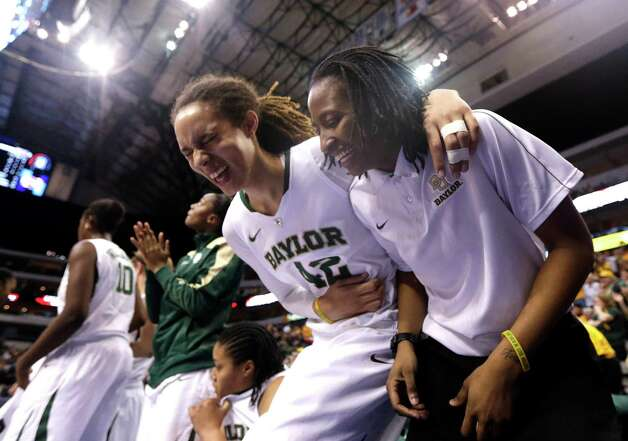 Baylor's Brittney Griner (42) laughs with Shanay Washington on the bench during the second half of an NCAA college basketball game against Kansas State in the Big 12 Conference tournament Saturday March 9, 2013, in Dallas. Baylor won 80-47. (AP Photo/LM Otero) Photo: LM Otero, Associated Press / AP