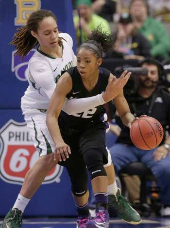 Baylor's Brittney Griner reaches in against Kansas State's Mariah White (22) during the first half of an NCAA college basketball game in the Big 12 Conference tournament Saturday March 9, 2013, in Dallas. Baylor won 80-47. (AP Photo/LM Otero) Photo: LM Otero, Associated Press / AP