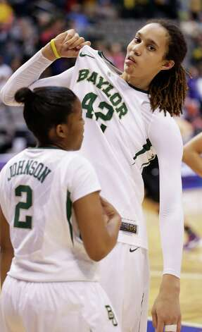Baylor's Brittney Griner (42) jokes around and pulls her jersey with teammate Niya Johnson (2) looking on during the second half of an NCAA college basketball game Kansas State in the Big 12 Conference tournament Saturday March 9, 2013, in Dallas. Baylor won 80-47. (AP Photo/LM Otero) Photo: LM Otero, Associated Press / AP