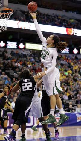 Baylor's Brittney Griner (42) shoots over Kansas State's Mariah White (22) during the second half of an NCAA college basketball game in the Big 12 women's tournament Saturday March 9, 2013, in Dallas. Baylor won 80-47. (AP Photo/LM Otero) Photo: LM Otero, Associated Press / AP