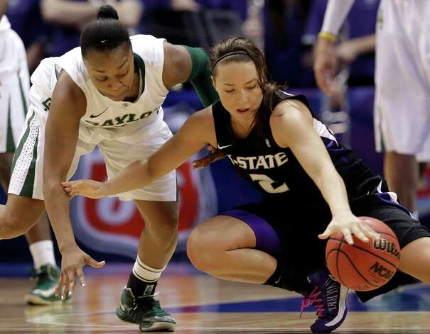 Baylor's Odyssey Sims, left, causes Kansas State's Brittany Chambers (2) to lose control of the ball during the second half of an NCAA college basketball game in the Big 12 Conference tournament on Saturday March 9, 2013, in Dallas. Baylor won 80-47. (AP Photo/LM Otero) Photo: LM Otero, Associated Press / AP