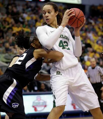 Baylor center Brittney Griner (42) works the ball against Kansas State's Marian White (22) during the first half of an NCAA college basketball game in the Big 12 Conference tournament Saturday March 9, 2013, in Dallas. (AP Photo/LM Otero) Photo: LM Otero, Associated Press / AP