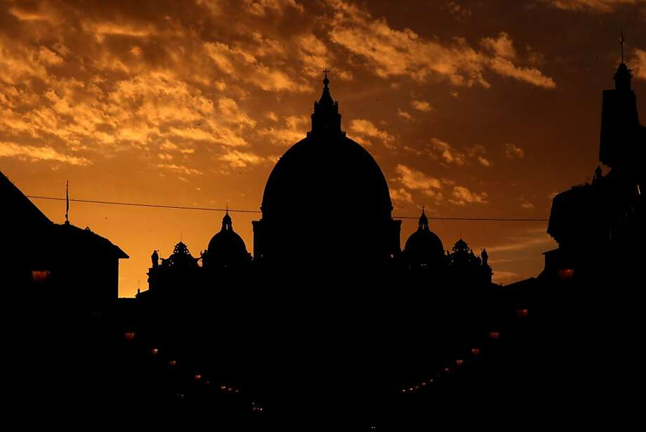 VATICAN CITY, VATICAN - MARCH 09:  The sun sets over St Peter's Basilica in St. Peter's Square as cardinals prepare to vote for a new pope on March 9, 2013 in Vatican City, Vatican. Cardinals are set to enter the conclave to elect a successor to Pope Benedict XVI after he became the first pope in 600 years to resign from the role. The conclave is scheduled to start on March 12 inside the Sistine Chapel and will be attended by 115 cardinals as they vote to select the 266th Pope of the Catholic Church.  (Photo by Dan Kitwood/Getty Images) Photo: Dan Kitwood, Getty Images