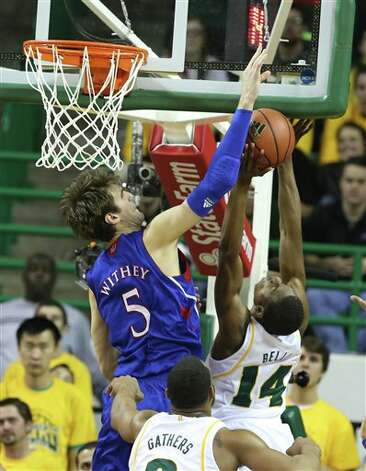 Kansas Jeff Withey (5), left, blocks the shot of Baylor's Deuce Bello (14), right, in the first half of a NCAA basketball game, Saturday,  March 9,  2013, in Waco, Texas. (AP Photo/Waco Tribune Herald, Rod Aydelotte) Photo: Rod Aydelotte, Associated Press / Waco Tribune Herald