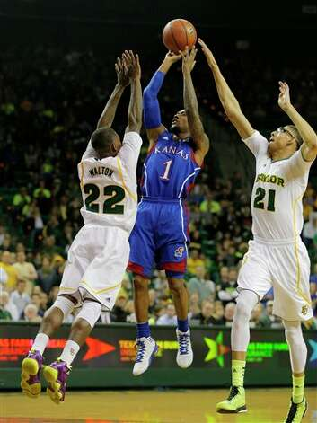 Kansas Naadir Tharpe (1), center, shoots between Baylor's A.J. Walton (22), left, and Isaiah Austin (21), right, in the first half of a NCAA basketball game, Saturday,  March 9,  2013, in Waco, Texas. (AP Photo/Waco Tribune Herald, Rod Aydelotte) Photo: Rod Aydelotte, Associated Press / Waco Tribune Herald