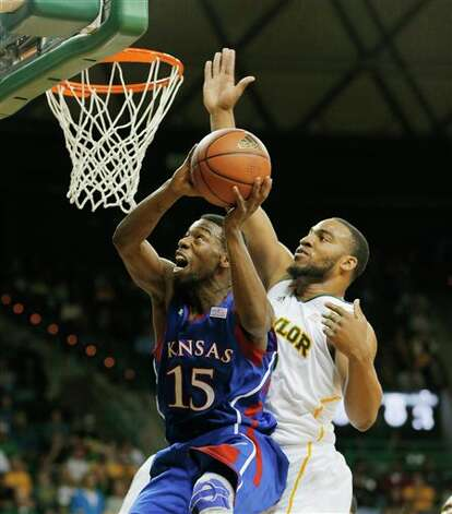Kansas Elijah Johnson (15), left, drives on Baylor's Rico Gathers (2), right, in the first half of a NCAA basketball game, Saturday,  March 9,  2013, in Waco, Texas. (AP Photo/Waco Tribune Herald, Rod Aydelotte) Photo: Rod Aydelotte, Associated Press / Waco Tribune Herald