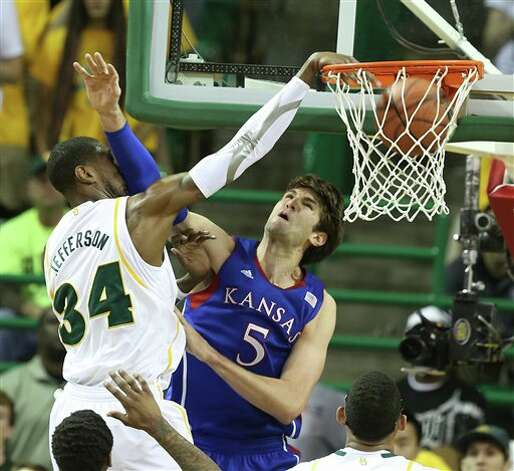 Baylor's Cory Jefferson (34), left, dunks over Kansas Jeff Withey (5) in the first half of an NCAA college basketball game on Saturday, March 9,  2013, in Waco, Texas. (AP Photo/Waco Tribune Herald, Rod Aydelotte) Photo: Rod Aydelotte, Associated Press / Waco Tribune Herald