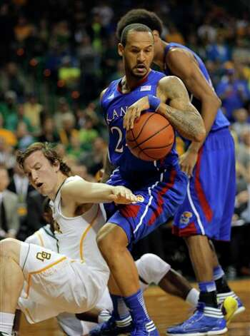 Kansas Trais Releford (24), right, grabs a loose ball over Baylor's Brady Heslip (5), left, in the first half of a NCAA basketball game, Saturday,  March 9,  2013, in Waco, Texas. (AP Photo/Waco Tribune Herald, Rod Aydelotte) Photo: Rod Aydelotte, Associated Press / Waco Tribune Herald