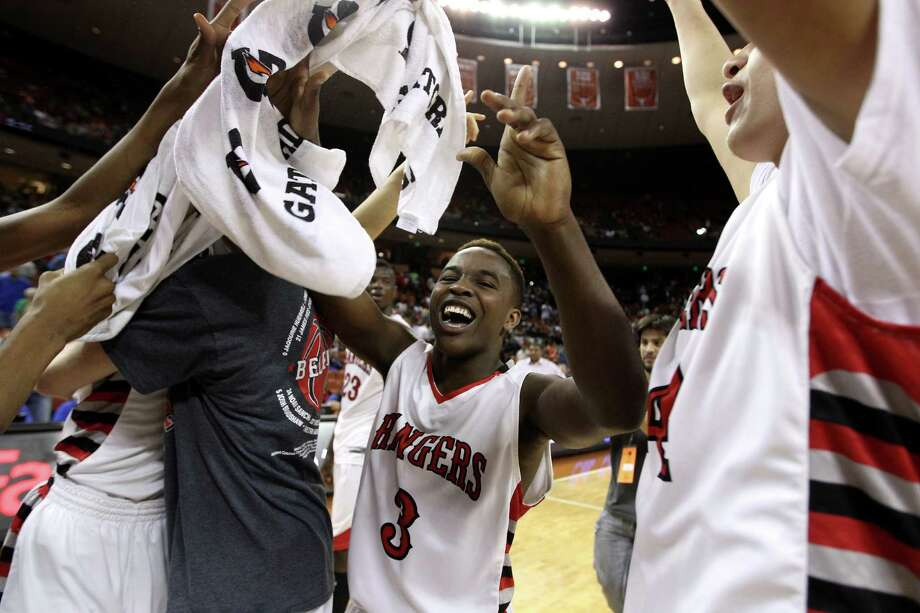 Rosenberg Terry's Michael Maxwell (3) celebrates with his teammates after their win over Dallas Kimball. Photo: Karen Warren, Houston Chronicle / © 2013 Houston Chronicle