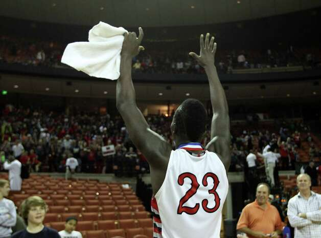 Rosenberg Terry's Derrick Griffin (23) celebrates with his teammates and fans after their win over Dallas Kimball. Photo: Karen Warren, Houston Chronicle / © 2013 Houston Chronicle