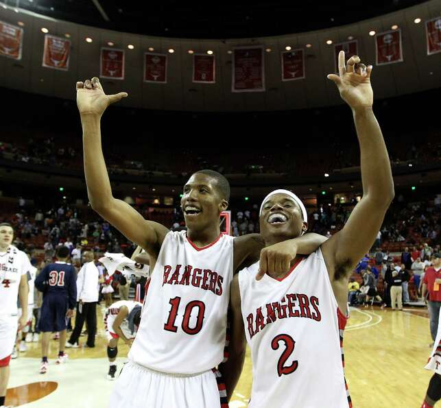 Rosenberg Terry's Dimetri Amerson (10) and Eugene Wright (2) celebrate after their win over Dallas K