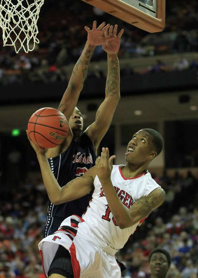 Roseberg Terry's Dimetri Amerson (10) goes up for a basket against Dallas Kimball's Keith Frazier (2) during the first half. Photo: Karen Warren, Houston Chronicle / © 2013 Houston Chronicle