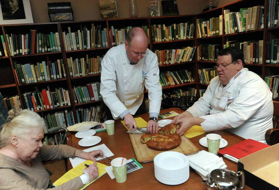 Maureen Mc Carthy, left, Chef Michael Kiernan, center, and Chef Peter Desmond judge the Irish Soda Bread Amateur Competition at the Irish American Heritage Museum on Saturday March 9, 2013 in Albany, N.Y. (Michael P. Farrell/Times Union) Photo: Michael P. Farrell