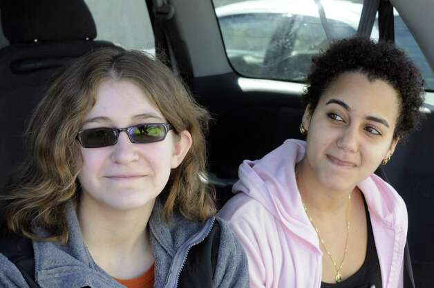 Bethlehem High School student Olivia Harmon, left, and HVCC student Yulie Carrazana-Markman at the Westview Apartments on Saturday March 9, 2013 in Albany, N.Y. (Michael P. Farrell/Times Union) Photo: Michael P. Farrell