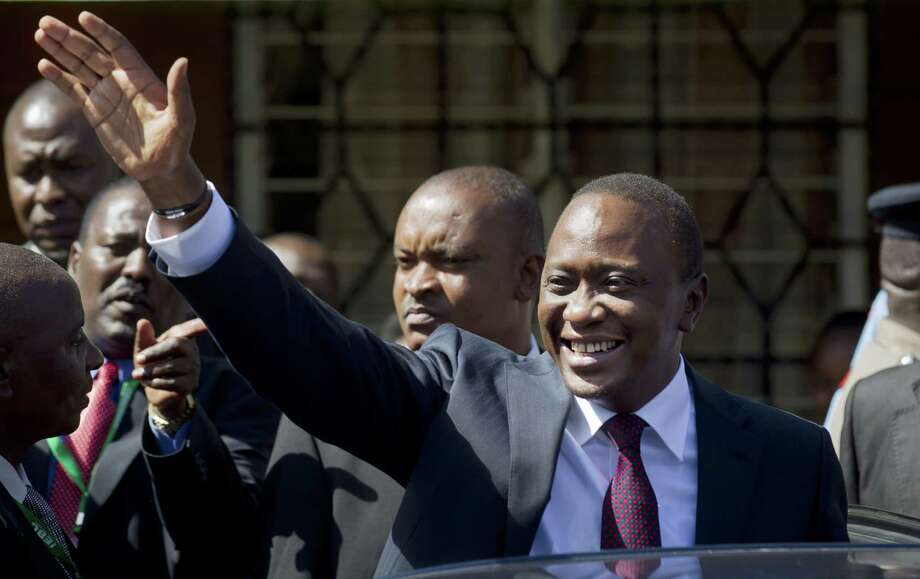 Uhuru Kenyatta, the son of Kenya's first president, was elected president amid accusations of vote fraud. He also faces trial in the International Court for allegedly bankrolling death squads. Photo: Ben Curtis / Associated Press