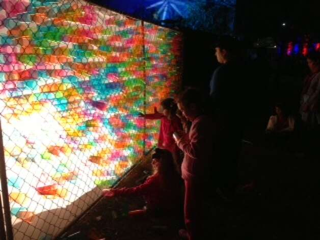 Kids play with the Lite-Brite fence next to the Magik Children's Theatre during Luminaria on Saturday, March 9, 2013. Photo: Emily Spicer / San Antonio Express-News