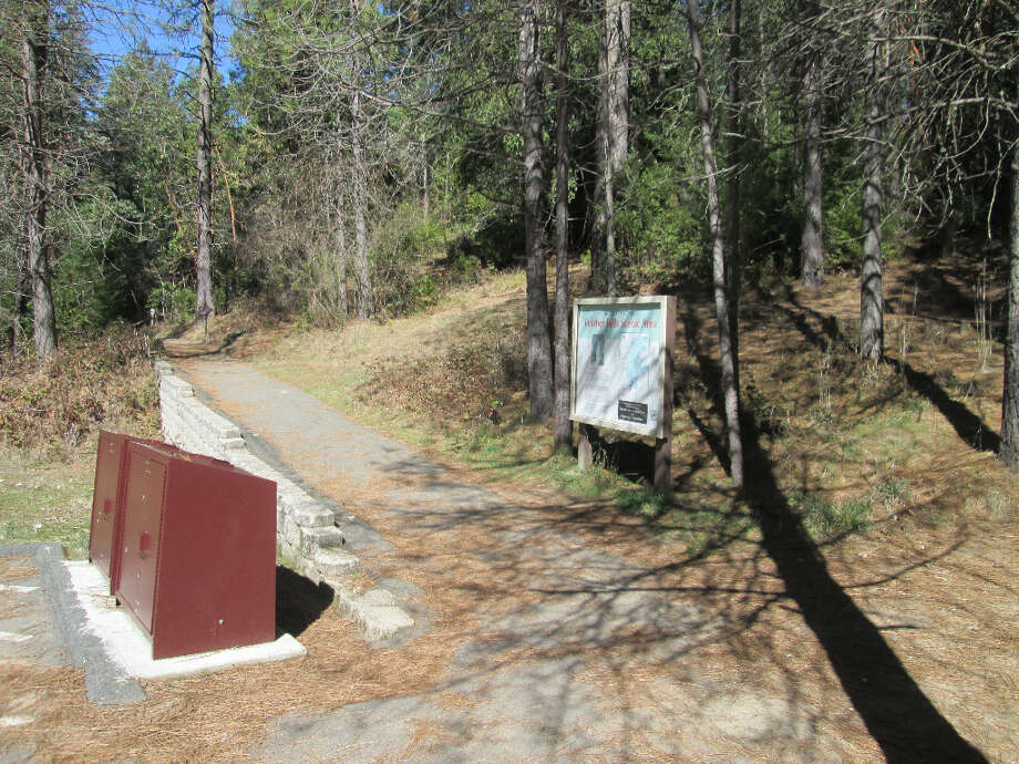 Billboard map and bear-proof cans at trailhead