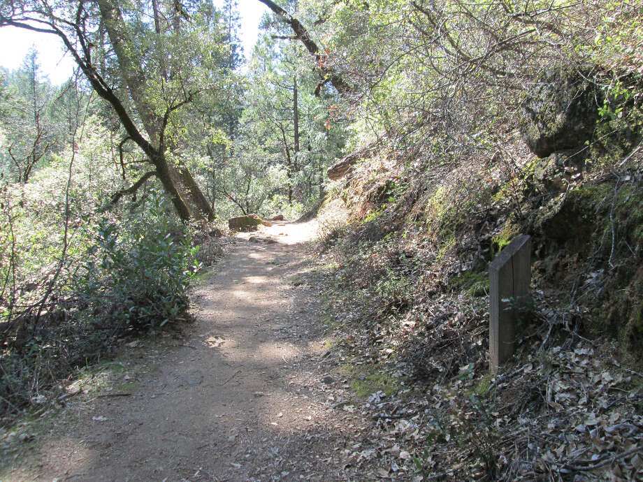 Mile Marker 2 appears on right as trail climbs up to sun-exposed ridge