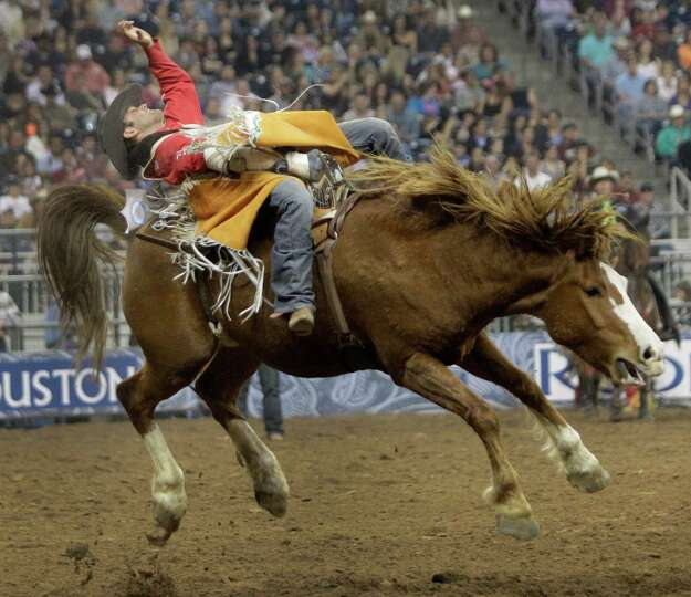 Casey Colletti rides and wins bareback event during the Super Shootout at RodeoHouston in Reliant St