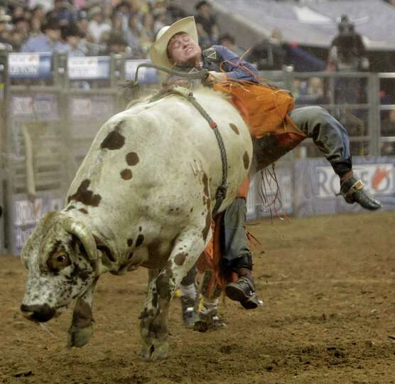Chris Roundy goes off the backside of a bull during the Super Shootout at RodeoHouston in Reliant St
