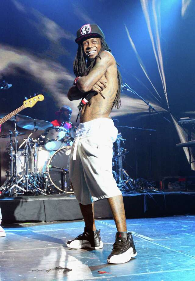 2012: Rapper Lil Wayne performs. Photo: Hutton Supancic, WireImage / 2012 Hutton Supancic