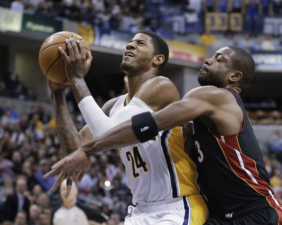 Paul George (left) and Indiana have beaten Dwyane Wade and Miami twice this season at home, but the Heat, who have won 17 games in a row, finally get the Pacers on their turf today. Photo: Darron Cummings / Associated Press