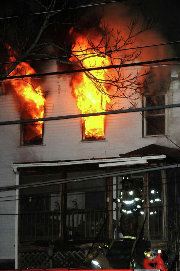 A home on the 500 block of 4th Street in Troy burns Saturday night. A woman died from the blaze. (Photo by IPA)