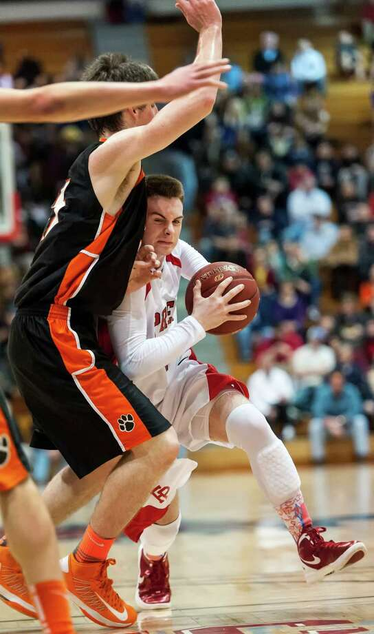 Fairfield Prep's Ryan Murphy drives to the basket in a quarterfinal round 2013 CIAC class LL boys basketball tournament game against Ridgefield high school held at Alumni Hall, Fairfield University, Fairfield CT on Saturday March 9th 2013. Photo: Mark Conrad / Connecticut Post Freelance