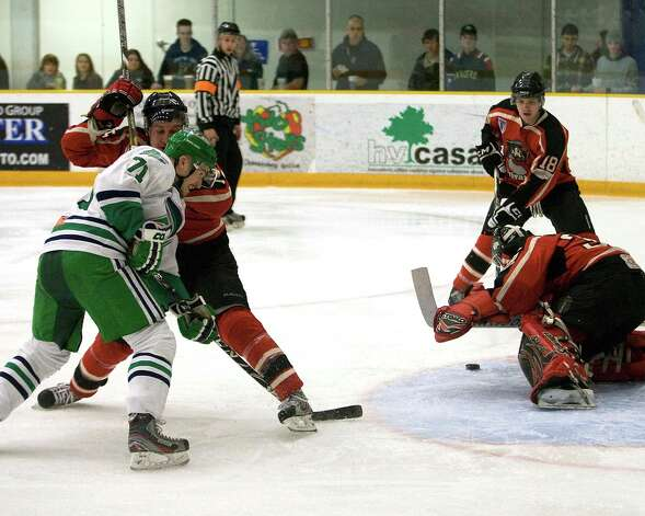 The Whalers' Kamil Vavra (71) tries to get around the Privateers' Sean Walsh and get to the puck that is pounced on by goalie Matt Anthony during FHL semifinal playoff play Saturday night, Mar. 9, 2013, at the Danbury Arena. Photo: Barry Horn / The News-Times Freelance