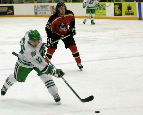 The Whalers' Alex Kirschner blasts a shot against the Thousand Islands Privateers during an FHL semifinal playoff game Saturday night, Mar. 9, 2013, at the Danbury Arena. Photo: Barry Horn / The News-Times Freelance